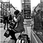 Photo: sidewalk cellist Clara Shandler